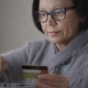 Elderly Woman Online Banking, Holding Credit Card