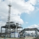 Power Station with Oil Well and Pipeline of Crude at Factory. Clouds in Blue Sky - VideoHive Item for Sale