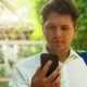 Man Using Smart Phone Outdoors in Summer - VideoHive Item for Sale