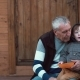 Grandson Sitting on Grandfather s Lap and Pointing with His Finger - VideoHive Item for Sale