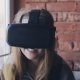 Young Woman Talks Wearing Virtual Reality Glasses