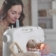 A Woman Sitting at a Modern Sewing Machine Enjoying Crafts and Hobbies - VideoHive Item for Sale