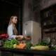 Young Woman Cooking Healthy Smoothie in Kitchen - VideoHive Item for Sale