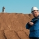 Young Redhead Bearded Caucasian Construction Worker in Blue Uniform