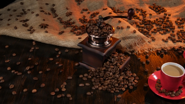 Antique Coffee Mill on Table with Two Cups of Latte