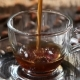 Black Coffee Is Poured Into Glass Transparent Cup on Saucer
