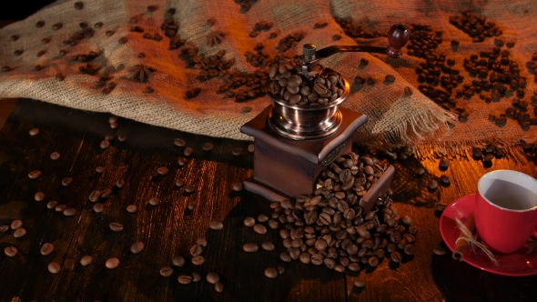 Table with a Coffee Grinder Full of with Coffee Beans