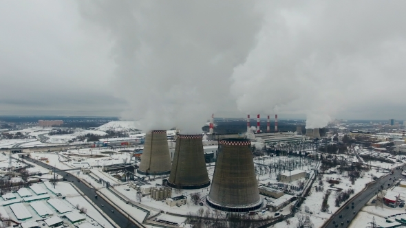 Thermal Power Plant. White Smoke From the Chimneys on Thermal Power Station. Aerial View
