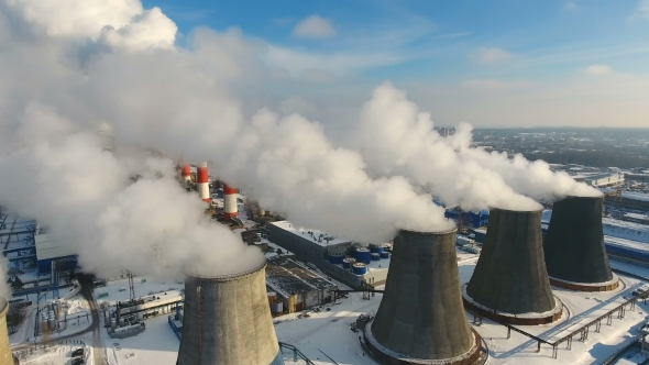 Industrial Chimneys Throwing Smoke in the Sky. Air Pollution Concept