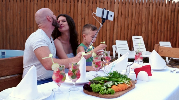 Family Photos Make the Mobile Phone Is Placed on a Stick Selfi, Cheerful Gatherings Parents
