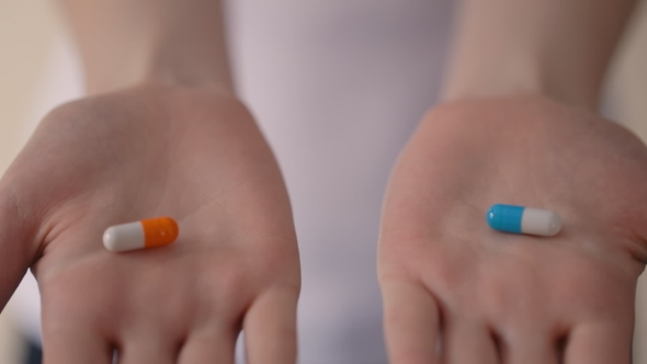 Woman Hands Holding Two Pills