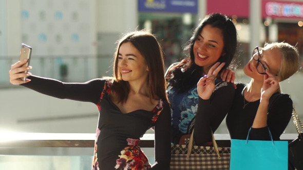 Attractive Pretty Women Taking Selfie After Shopping. Girls Are Very Happy, Smiling. They Posing for