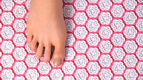 Female Feet Gently Tread on Acupuncture Massage Mat