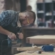 Stylish Craftsman at His Workstation. Modern Woodworker with Tattoo. - VideoHive Item for Sale