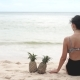 Woman Sitting on the Beach with Two Pineapples - VideoHive Item for Sale