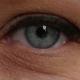 Woman Opening Her Blue Eye