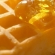 Baked Golden Waffle and Sweet Pouring Honey