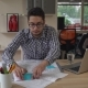Handsome Mixed Race Man Use Sticky Notes on Documents