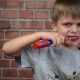 Little Boy in the Bathroom Brushing Her Teeth with Electric Toothbrush,  Video