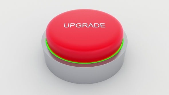 Big Red Button With Upgrade Inscription Being Pushed By Moovstock