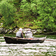 Old Men Sitting In A Boat With A Fishing Rod