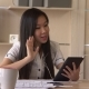 Asian Businesswoman Has Video Call with Client.