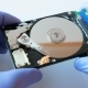 Engineer Is Disassembling Broken Hard Disk Drive for Data Recovery. - VideoHive Item for Sale