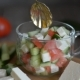Salad with Vegetables and Cheese, Ingredients. Stir with a Spoon.