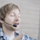 Friendly Young Call Center Worker with Headset Talking with Client in Agency - VideoHive Item for Sale