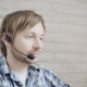 Young Male Operator of Call Center with Headset Using Laptop - VideoHive Item for Sale