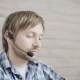 Young Tired Male Operator of Call Center with Headset Using Laptop - VideoHive Item for Sale