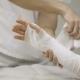 Doctor Puts Gypsum Pad on Patient's Hand
