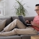 Man with Laptop and Credit Card on Sofa at Home 13