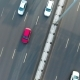 AERIAL: Cars Drive Through the Road. Camera Rotating Above Highway. Nulled