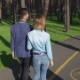 A Cute Couple Is Walking Along the Path in the Forest.