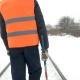 Worker with a Sledgehammer Goes Along the Railway