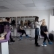 Professional Hair Stylist and Makeup Artist in Their Large Studio Preparing Models Before Going on