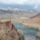 Turquoise River, Steppe, Red Rocks and Snowy Mountains