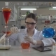 Professional Scientist Pouring Liquid To Glass Bulb