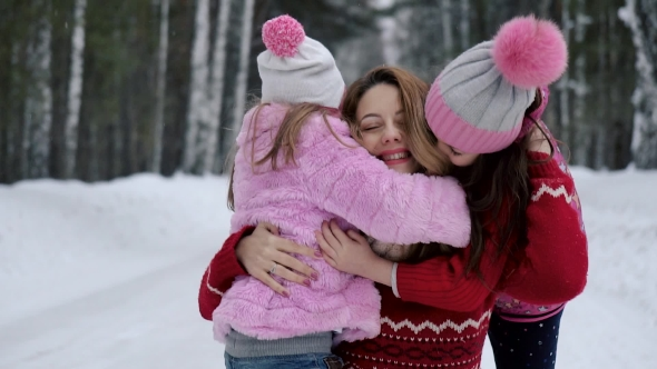 Children Hugging Mother. the Child Is Happy. Mom and Daughter.