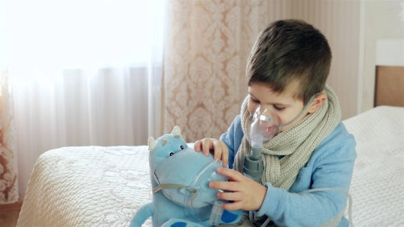 Nebulizer for Inhalation, Sick Child Breathes Through Nebulizer, Baby Does Inhalation
