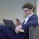 Young Male Relaxing Use Mobile Phone