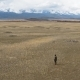 Aerial Scene Man Looks Horizon, Ancient Mound, Steppe, Mountains, Snowy Peaks - VideoHive Item for Sale