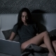 Female Sitting on Bed with Laptop