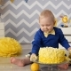 A Small Boy Eating Cake Using Hands. Mess in a Room During Birthday Party. Nulled