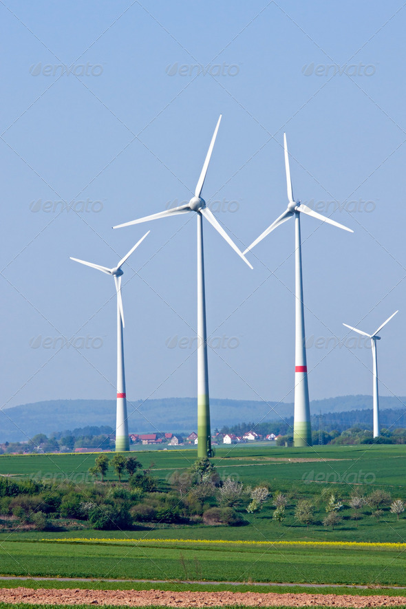 Four windwheels in the fields - Stock Photo - Images