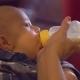 Cute Baby Enjoy Milk in Bottle