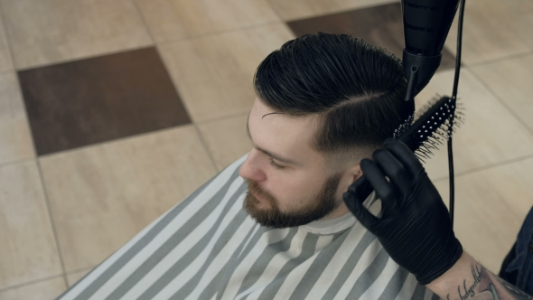 VideoHive Barber Getting Groomed at Hairdresser with Hair Dryer While Sitting in Chair at Barbershop 19617929