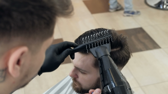 VideoHive Barber Getting Groomed at Hairdresser with Hair Dryer While Sitting in Chair at Barbershop 19618120