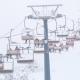 Lift at Ski Resort Transports Skiers
